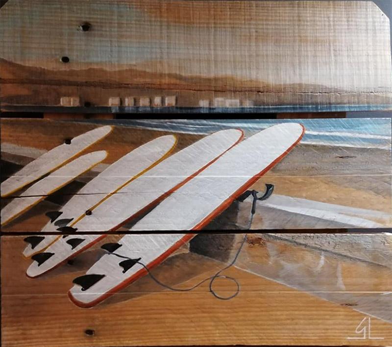 planches de surf peintes sur palettes par Gilles Lavie